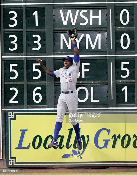 Alfonso Soriano of the Chicago Cubs makes a leaping catch at the wall on a ball hit by Matt Dominguez of the Houston Astros in the fifth inning at...