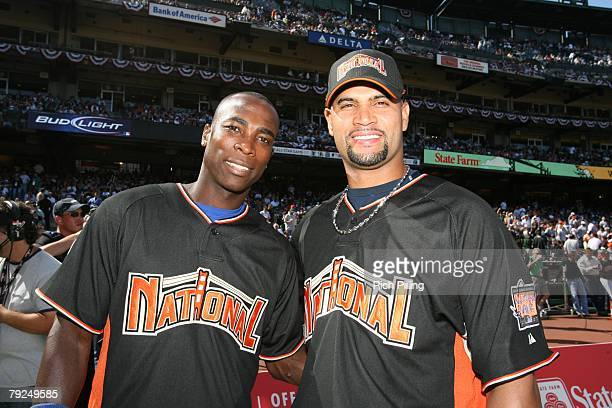 Alfonso Soriano of the Chicago Cubs poses with Albert Pujols of the St Louis Cardinals during the GATORADE AllStar Workout Day at ATT Park in San...