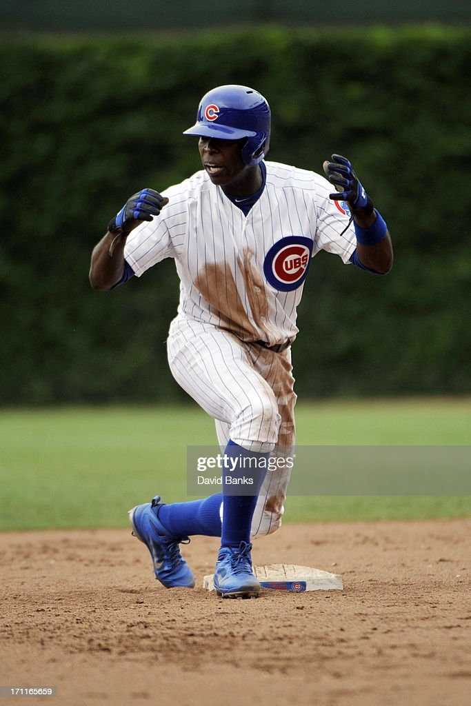 Alfonso Soriano #12 of the Chicago Cubs reacts after being thrown out at second base against the Houston Astros during the eighth inning on June 22, 2013 at Wrigley Field in Chicago, Illinois.