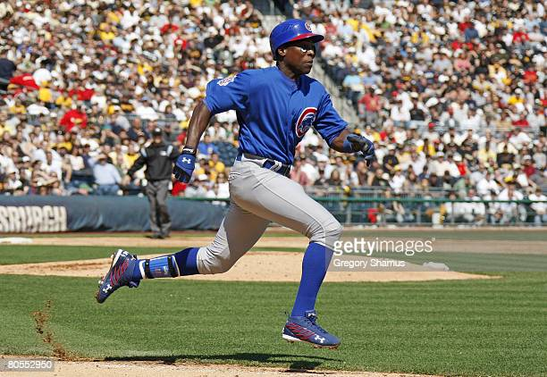 Alfonso Soriano of the Chicago Cubs runs down the first base line to beat out the throw to first base during the Home Opener for the Pittsburgh...