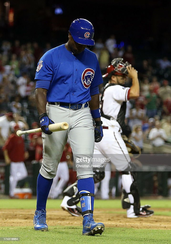 Alfonso Soriano #12 of the Chicago Cubs walks off the field after striking out to end the MLB game against the Arizona Diamondbacks at Chase Field on July 23, 2013 in Phoenix, Arizona. The Diamondbacks defeated the Cuibs 10-4.