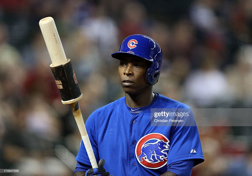 Alfonso Soriano #12 of the Chicago Cubs warms up on deck during the MLB game against the Arizona Diamondbacks at Chase Field on July 23, 2013 in Phoenix, Arizona. The Diamondbacks defeated the Cuibs 10-4.