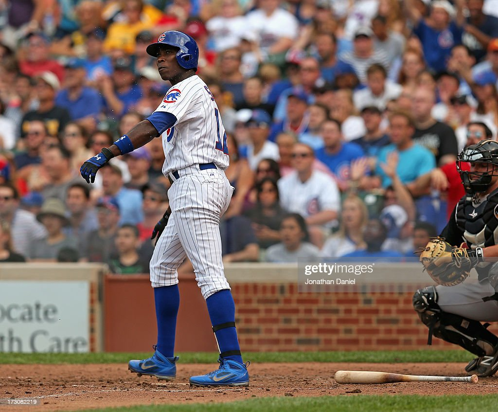 Alfonso Soriano #12 of the Chicago Cubs watches as his second two-run home run of the game sails out of the park in the 5th inning against the Pittsburgh Pirates at Wrigley Field on July 6, 2013 in Chicago, Illinois.