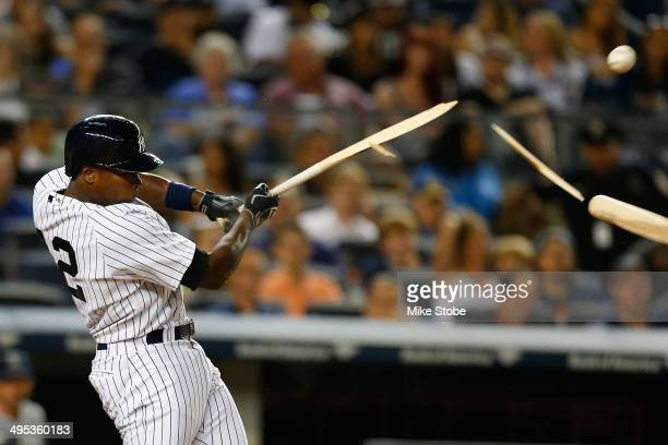 Alfonso Soriano of the New York Yankees breaks his bat fouling the ball off in the sixth inning against the Seattle Mariners at Yankee Stadium on...