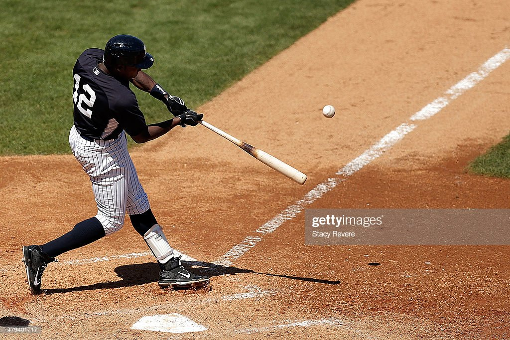 Alfonso Soriano #12 of the New York Yankees hits a home run in the fourth inning of a game against the Boston Red Sox at George M. Steinbrenner Field on March 18, 2014 in Tampa, Florida.