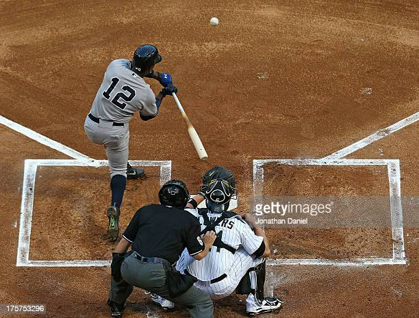 Alfonso Soriano of the New York Yankees hits a tworun home run in the 1st inning against the Chicago White Sox at US Cellular Field on August 7 2013...