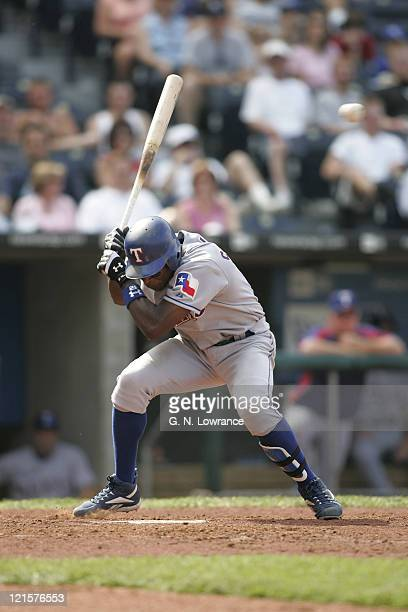 Alfonso Soriano of the Texas Rangers avoids a pitch during a game against the Kansas City Royals at Kauffman Stadium in Kansas City Mo on June 4 2005...