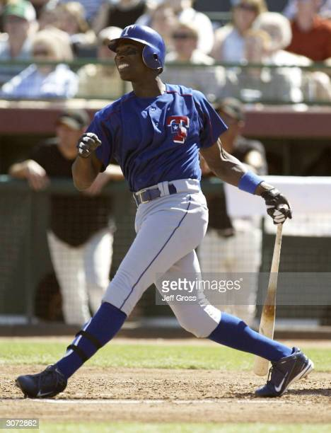 Alfonso Soriano of the Texas Rangers hits a single in the second inning during a spring training game against the San Francisco Giants on March 10...