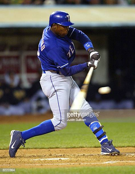Alfonso Soriano of the Texas Rangers swings at a pitch against the Oakland A's at Network Associates Coliseum on April 5, 2004 in Oakland, California.