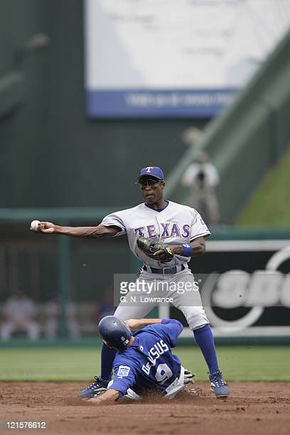 Alfonso Soriano of the Texas Rangers throws to complete a double play during a game against the Kansas City Royals at Kauffman Stadium in Kansas City...