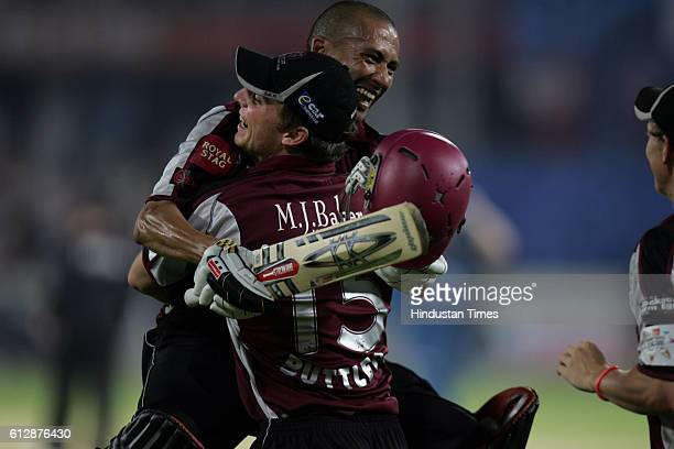 Alfonso Thomas of Somerset celebratesafter hitting the winning runs during the Airtel Champions League Twenty20 Group A match between the Deccan...