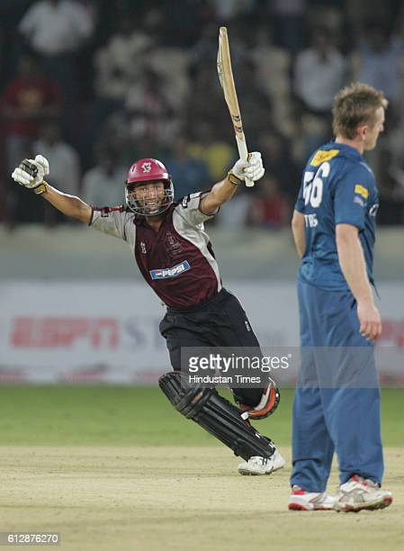 Alfonso Thomas of Somerset hits a wining shot as he celebrates the victory against Deccan Chargers on the last ball during the Airtel Champions...