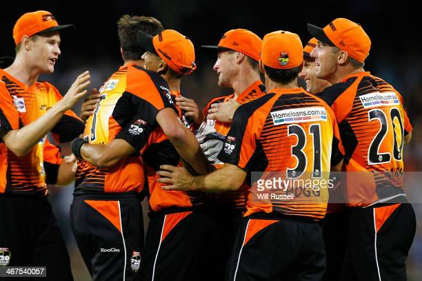 Alfonso Thomas of the Perth Scorchers celebrates after taking a catch to dismiss George Bailey of the Hobart Hurricanes during the Big Bash League...