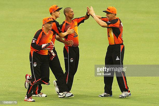 Alfonso Thomas of the Scorchers celebrates taking a catch off Luke Wright during the Big Bash League semifinal match between the Perth Scorchers and...