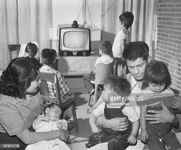 MAR 17 1957 Alfonso Vigil the obedient burglar has a reunion with his family after being released without bond on his plea of guilty His wife Corina...