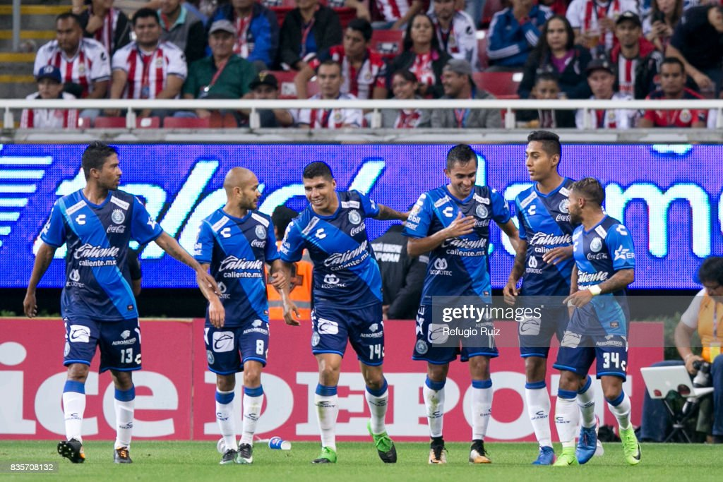 Alfonso Zamora of Puebla celebrates with teammates after scoring the first goal of his team during the fifth round match between Chivas and Puebla as part of the Torneo Apertura 2017 Liga MX at Chivas Stadium on August 19, 2017 in Zapopan, Mexico.