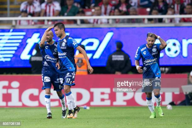 Alfonso Zamora of Puebla celebrates with teammates after scoring the first goal of his team during the fifth round match between Chivas and Puebla as...