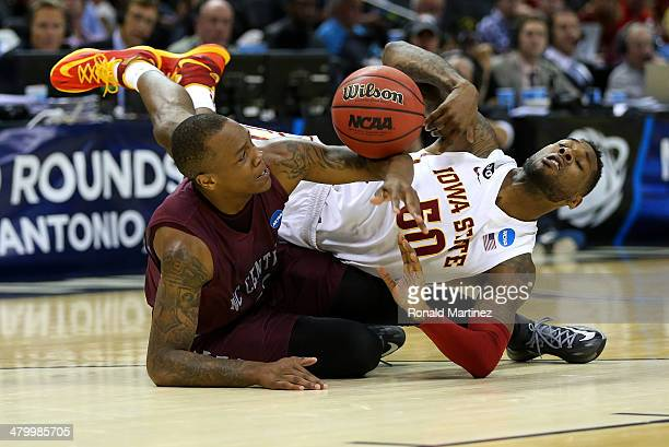 Alfonzo Houston of the North Carolina Central Eagles and DeAndre Kane of the Iowa State Cyclones go after a loose ball during the second half of the...