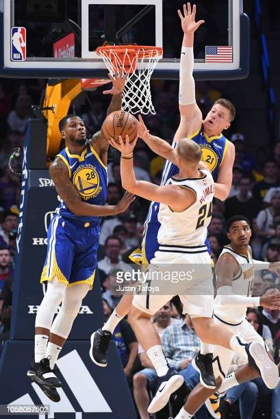 Alfonzo McKinnie and Jonas Jerebko of the Golden State Warriors contest a shot from Mason Plumlee of the Denver Nuggets at Pepsi Center on October 21...