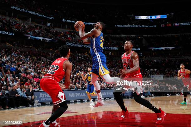 Alfonzo McKinnie of the Golden State Warriors drives to the basket against the Chicago Bulls on October 29 2018 at United Center in Chicago Illinois...