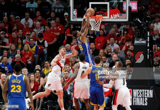 Alfonzo McKinnie of the Golden State Warriors dunks the ball during the first half against the Portland Trail Blazers in game four of the NBA Western...