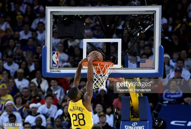 Alfonzo McKinnie of the Golden State Warriors goes in for a slam dunk against the Los Angeles Lakers during the first half of their NBA Basketball...