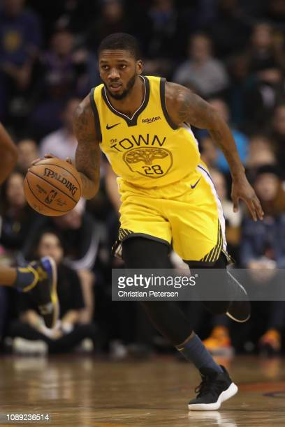 Alfonzo McKinnie of the Golden State Warriors handles the ball during the second half of the NBA game against the Phoenix Suns at Talking Stick...
