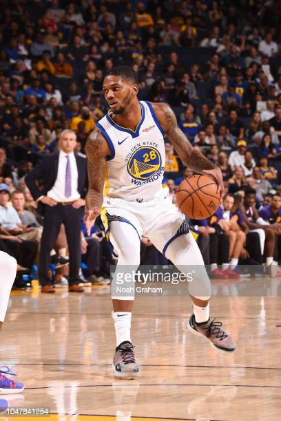 Alfonzo McKinnie of the Golden State Warriors handles the ball against the Phoenix Suns during a preseason game on October 8 2018 at ORACLE Arena in...