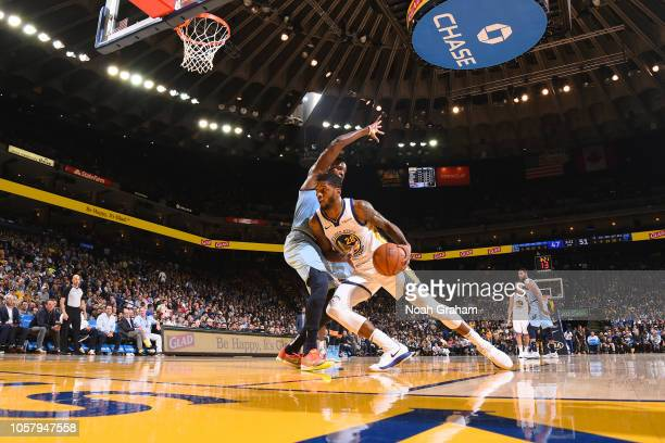 Alfonzo McKinnie of the Golden State Warriors handles the ball against the Memphis Grizzlies on November 5 2018 at ORACLE Arena in Oakland California...