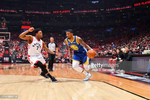Alfonzo McKinnie of the Golden State Warriors handles the ball against the Toronto Raptors during Game Two of the NBA Finals on June 2 2019 at...