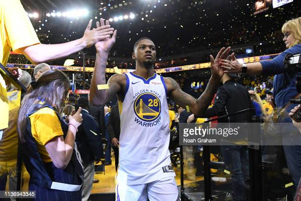 Alfonzo McKinnie of the Golden State Warriors highfives fans on the way to the locker room after the game against the LA Clippers during Game One of...