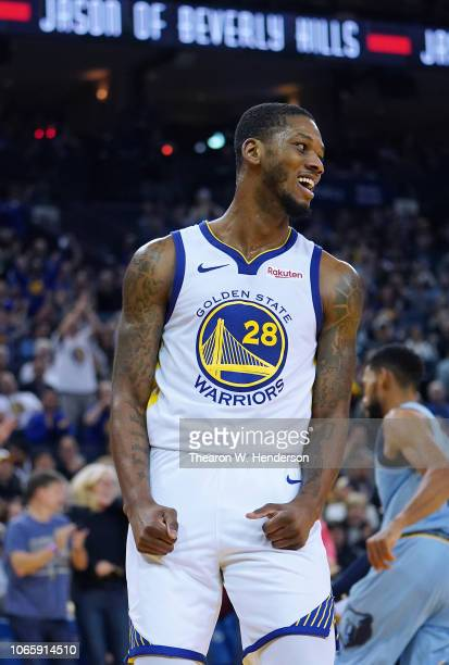 Alfonzo McKinnie of the Golden State Warriors reacts after a slam dunk against the Memphis Grizzlies during an NBA basketball game at ORACLE Arena on...