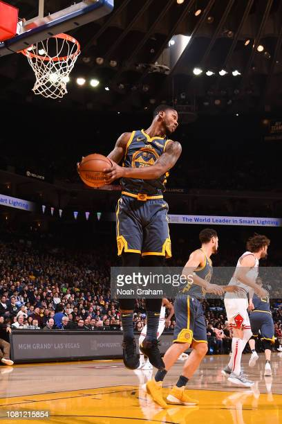 Alfonzo McKinnie of the Golden State Warriors rebound sthe ball against the Chicago Bulls on January 11 2019 at ORACLE Arena in Oakland California...