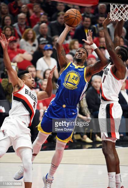 Alfonzo McKinnie of the Golden State Warriors shoots the ball during the first half against the Portland Trail Blazers in game four of the NBA...