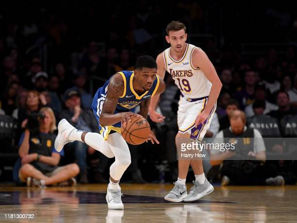Alfonzo McKinnie of the Golden State Warriors takes a rebound up court in front of David Stockton of the Los Angeles Lakers during a 10498 Lakers...