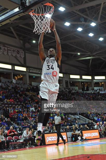 Alfonzo McKinnie of the Raptors 905 dunks the ball against the Greensboro Swarm during the NBA GLeague game at the Hershey Centre in Mississauga...