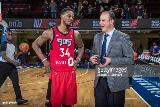 Alfonzo McKinnie of the Raptors 905 speaks to Head Coach Mike Miller of the Westchester Knicks after the game during the NBA GLeague on February 24...