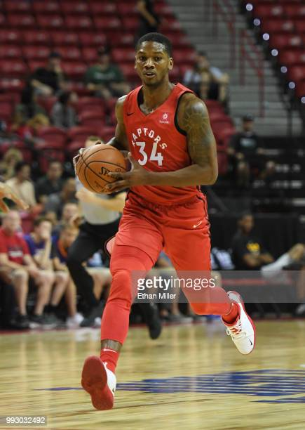 Alfonzo McKinnie of the Toronto Raptors brings the ball up the court against the New Orleans Pelicans during the 2018 NBA Summer League at the Thomas...