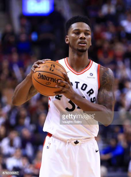 Alfonzo McKinnie of the Toronto Raptors dribbles the ball during the second half of an NBA game against the New York Knicks at Air Canada Centre on...