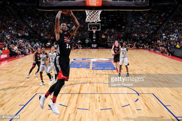 Alfonzo McKinnie of the Toronto Raptors dunks the ball during the game against the Minnesota Timberwolves during the 2017 Las Vegas Summer League on...