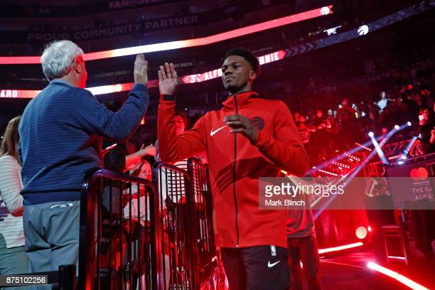 Alfonzo McKinnie of the Toronto Raptors gets introduced before the game against the Chicago Bulls on October 19 2017 at the Air Canada Centre in...
