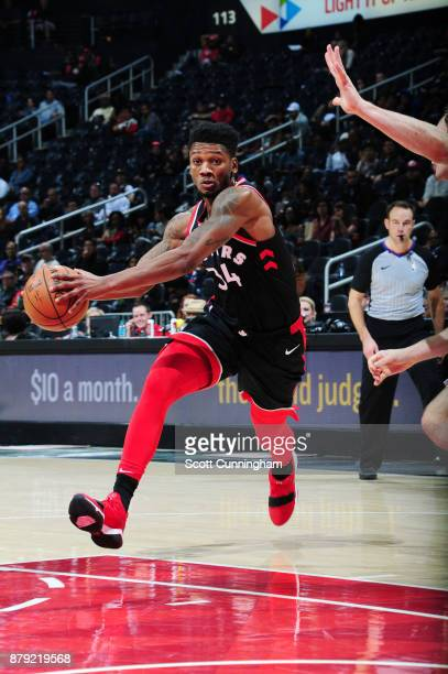 Alfonzo McKinnie of the Toronto Raptors handles the ball against the Atlanta Hawks on November 25 2017 at Philips Arena in Atlanta Georgia NOTE TO...