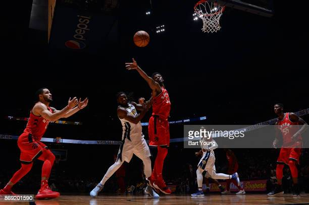 Alfonzo McKinnie of the Toronto Raptors passes the ball against the Denver Nuggets on November 1 2017 at the Pepsi Center in Denver Colorado NOTE TO...