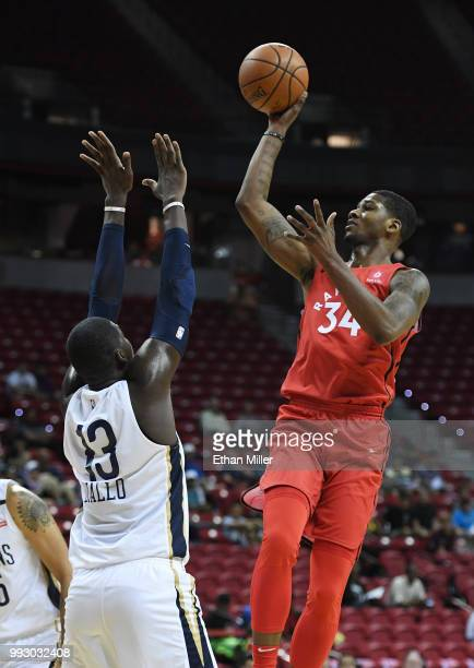 Alfonzo McKinnie of the Toronto Raptors shoots against Cheick Diallo of the New Orleans Pelicans during the 2018 NBA Summer League at the Thomas Mack...