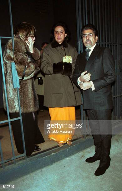Alfred A Knoph President Ajai Singh Sonny Mehta right stands with two unidentified companions after the party to celebrate the wedding of media mogul...