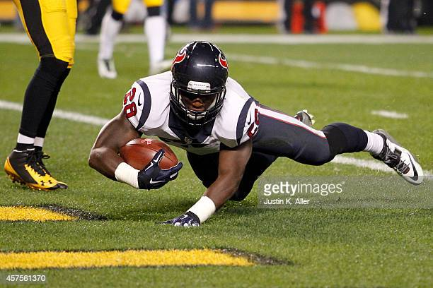 Alfred Blue of the Houston Texans catches a 11 yard touchdown pass thrown by Ryan Fitzpatrick in the first quarter against the Pittsburgh Steelers...