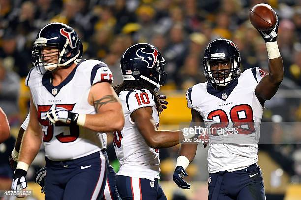 Alfred Blue of the Houston Texans celebrates with his teammate DeAndre Hopkins after scoring an 11 yard touchdown pass thrown by Ryan Fitzpatrick in...