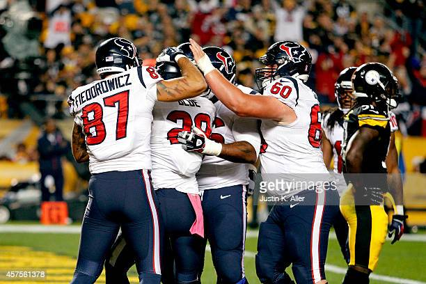 Alfred Blue of the Houston Texans celebrates with his teammates after scoring an 11 yard touchdown pass thrown by Ryan Fitzpatrick in the first...