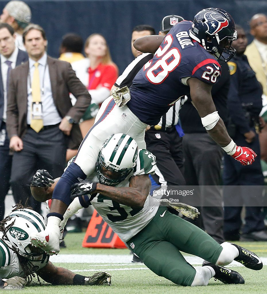Alfred Blue #28 of the Houston Texans is tackled by Antonio Cromartie #31 of the New York Jets in the second half on November 22, 2015 at NRG Stadium in Houston, Texas. Texans won 24 to 17.