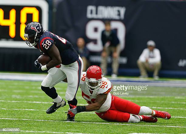 Alfred Blue of the Houston Texans is tackled by Derrick Johnson of the Kansas City Chiefs in the second half at NRG Stadium on September 18 2016 in...